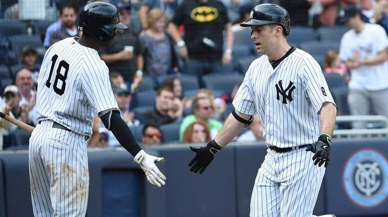 New York Yankees shortstop Didi Gregorius congratulates New