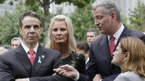 New York Gov. Andrew Cuomo, left, listens to