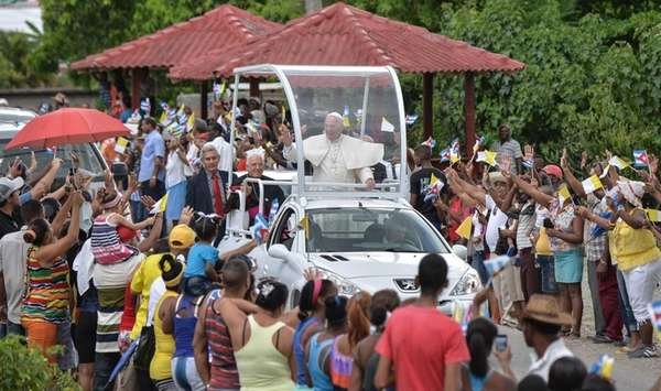 Pope Francis waves from the popemobile upon his
