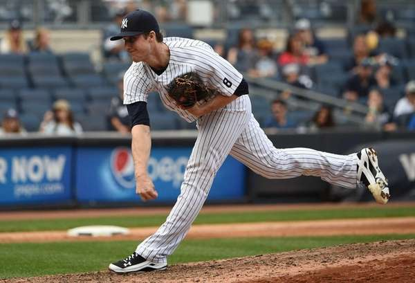 New York Yankees relief pitcher Bryan Mitchell delivers