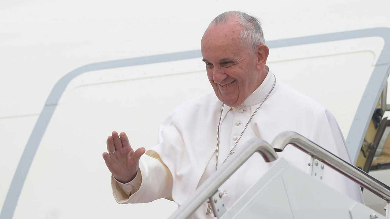 Pope Francis waves as he steps off his