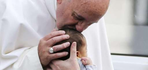 Pope Francis kisses a baby in Philadelphia on