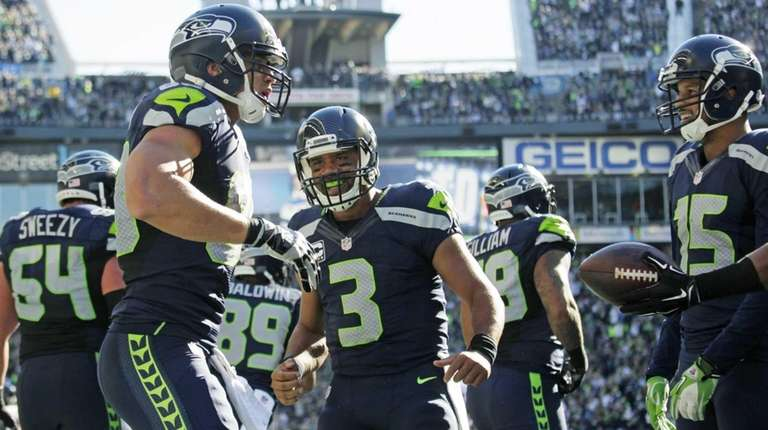 Seattle Seahawks quarterback Russell Wilson (3) celebrates with
