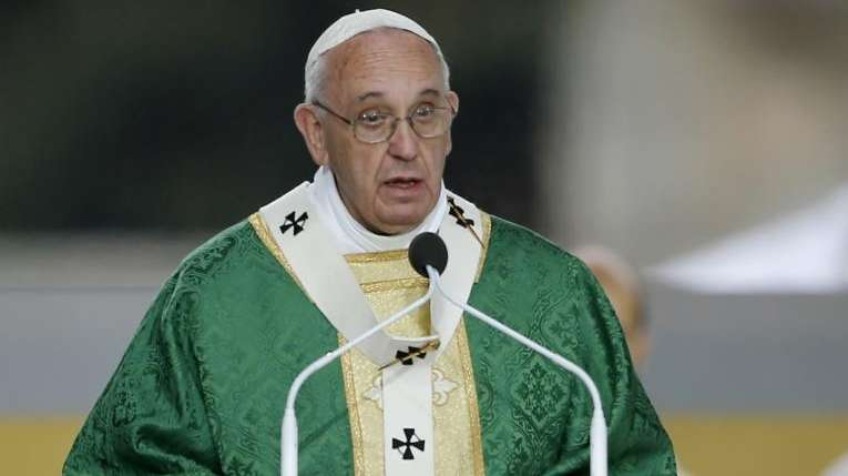 Pope Francis delivers his homily while celebrating Mass