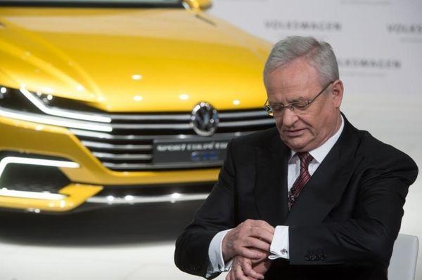 Volkswagen CEO Martin Winterkorn looks at his watch