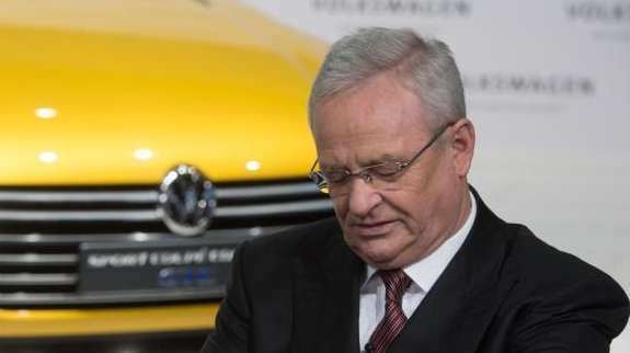 Volkswagen CEO Martin Winterkorn looks at his watch