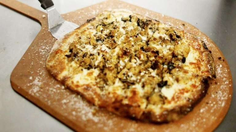 A cauliflower pizza is served at Anthony's Coal