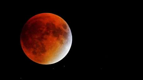 An eclipsed supermoon is seen on Sept. 27,