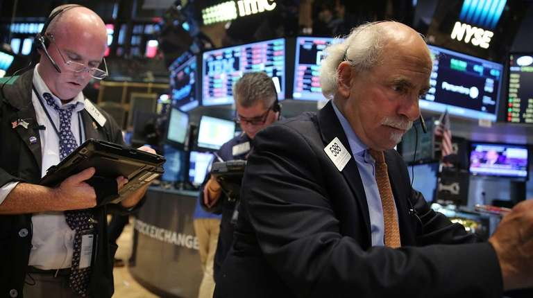 Stocks slid in early trading Monday, Sept. 28,