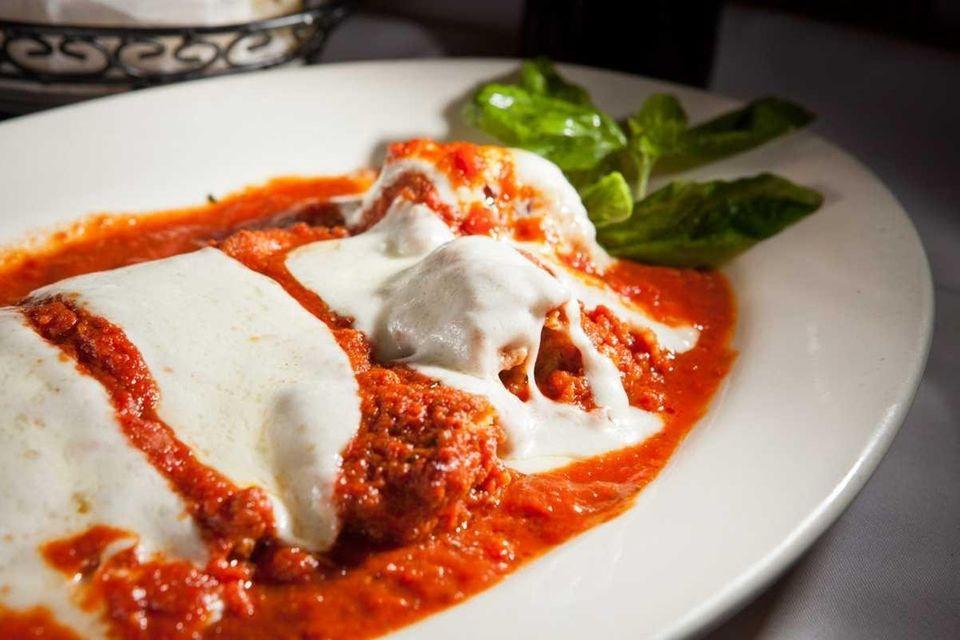 Taormina, Commack: Chef co-owner Giuseppe Maccarrone dips eggplant