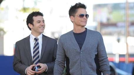 Fred Savage, left, and Rob Lowe in