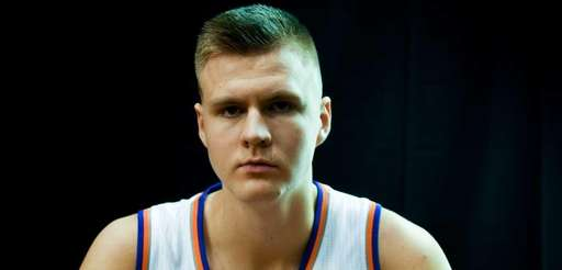 The New York Knicks' Kristaps Porzingis poses during