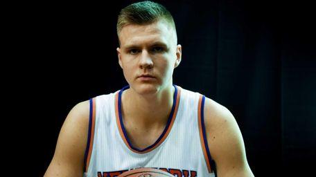 The New York Knicks' Kristaps Porzingis poses during