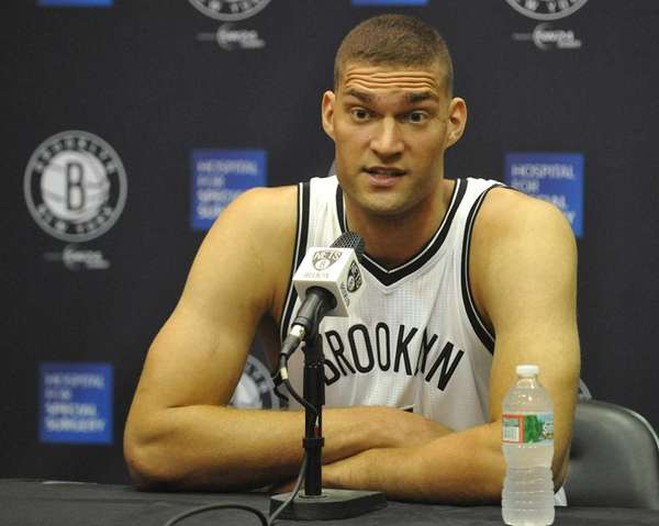 Brooklyn Nets Brook Lopez fields questions during Media