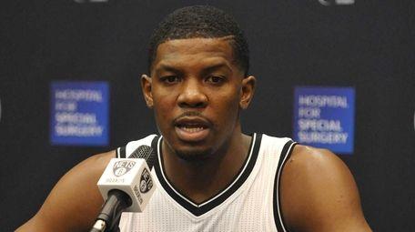 Brooklyn Nets guard Joe Johnson fields questions during