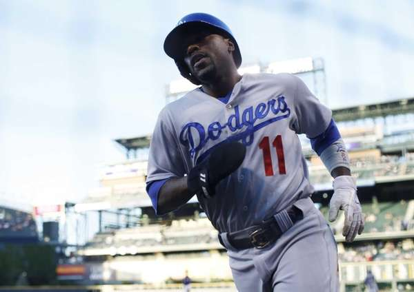 Los Angeles Dodgers' Jimmy Rollins heads to the