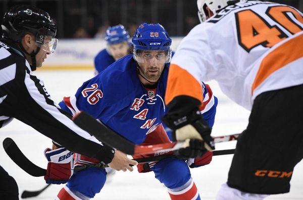 New York Rangers center Jarret Stoll faces off