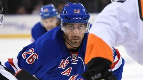 New York Rangers center Jarret Stoll faces off