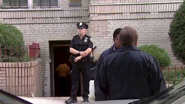 Police patrol outside a Bronx building where a