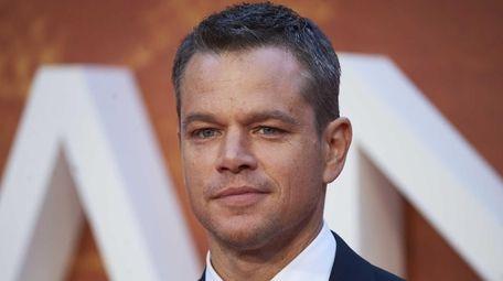 Actor Matt Damon poses for photographers as he