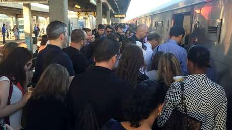 Commuters board a westbound Long Island Rail Road