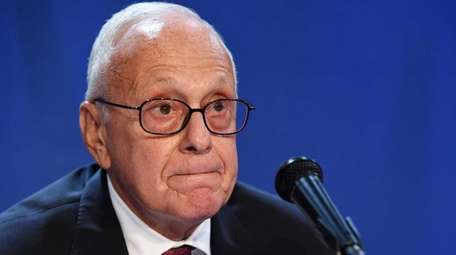 SMU men's basketball head coach Larry Brown pauses