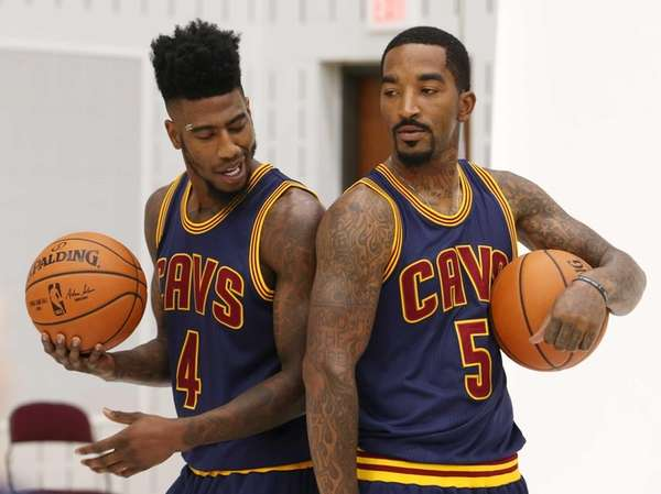 Cleveland Cavaliers' Iman Shumpert, left, and J.R. Smith