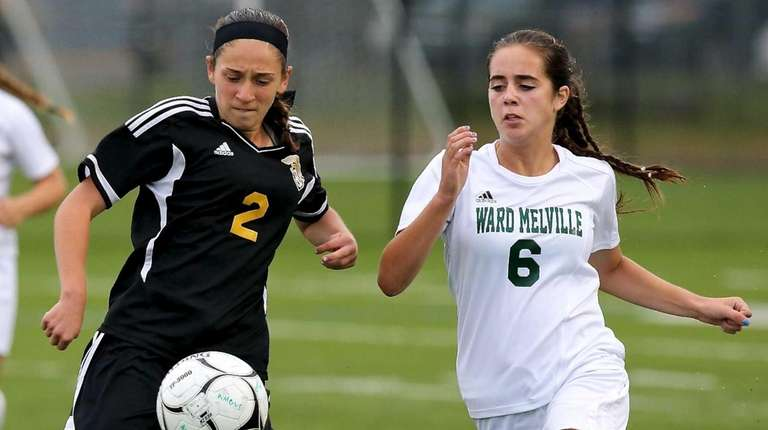 Commack forward Allison Seidman passes the ball past
