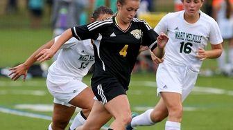 Commack midfielder Danielle Sclafani moves the ball past