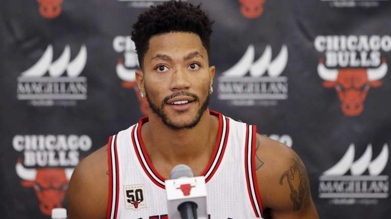 Chicago Bulls guard Derrick Rose sits down for