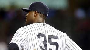 Michael Pineda of the Yankees looks on after