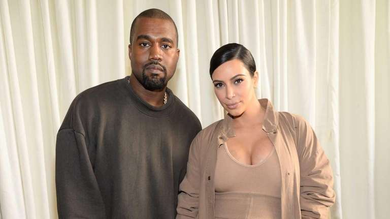 Kanye West and Kim Kardashian West attend attend
