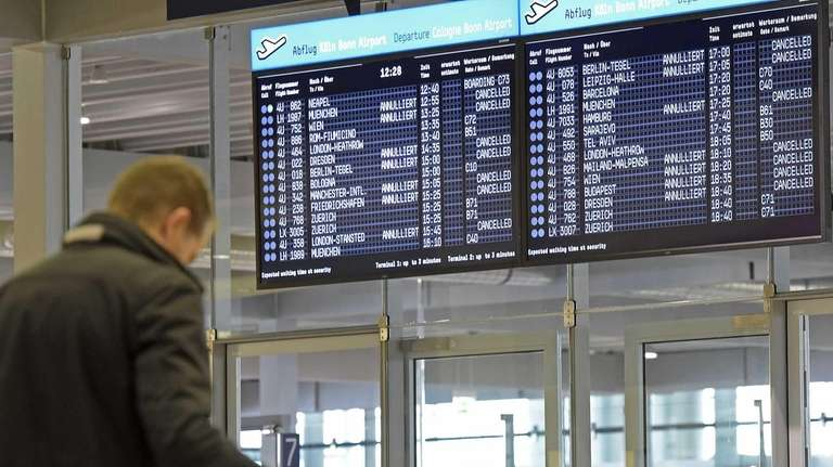 Business travelers stuck in airports due to unforeseen