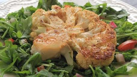 Cauliflower steak is lightly brushed with olive oil,