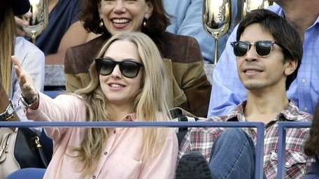 Amanda Seyfried, left, and Justin Long, right, watch