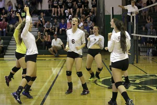 The Kings Park girls volleyball team celebrates their