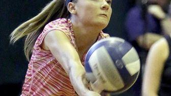 Westhampton libero Isabelle Smith (32) cradles the ball