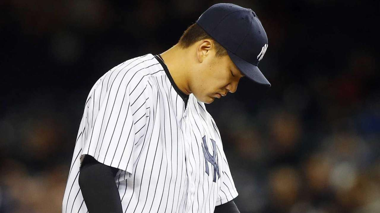Masahiro Tanaka of the Yankees stands on the