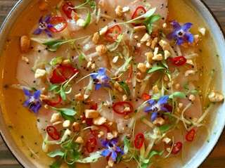 Hamachi crudo with passion fruit, chilies, corn nuts