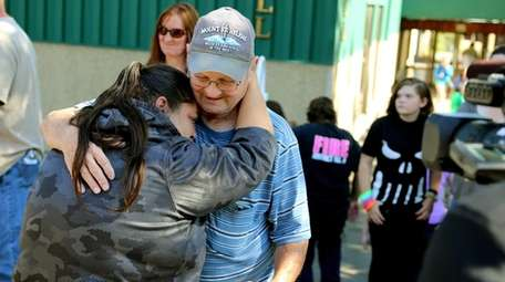 Friends and family are reunited with students at