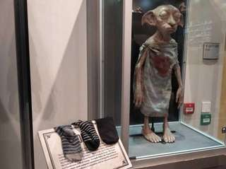 A Dobby figure is surrounded by socks at