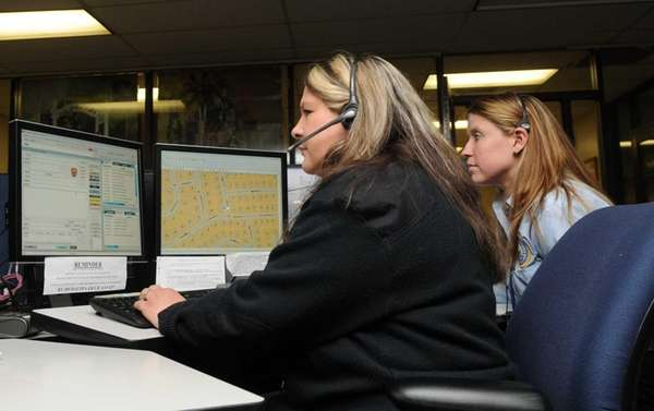 Suffolk County police 911 dispatchers work the phones