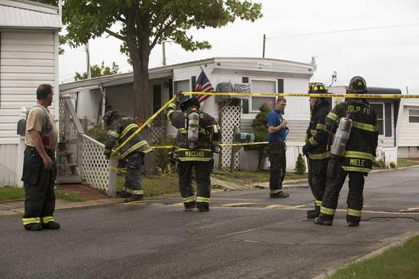 The Islip Fire Department secures a mobile home