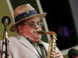 Jazz musician Phil Woods plays his saxophone with
