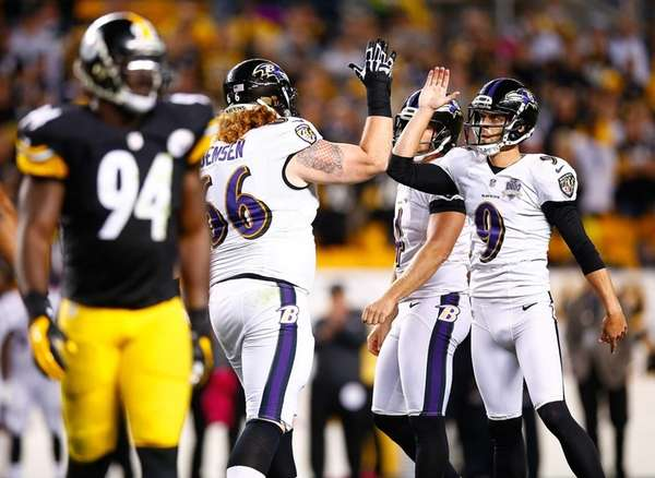 Ryan Jensen of the Baltimore Ravens celebrates with