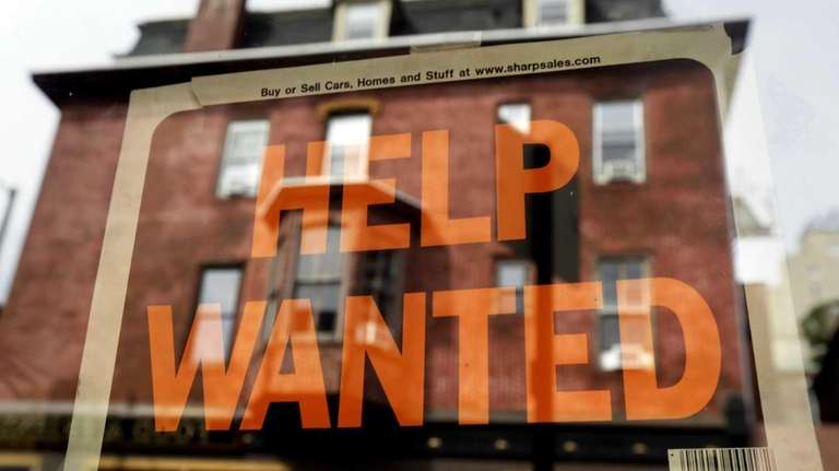 A Philadelphia business displays a help anted sign