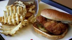 An original chicken sandwich and waffle fries at