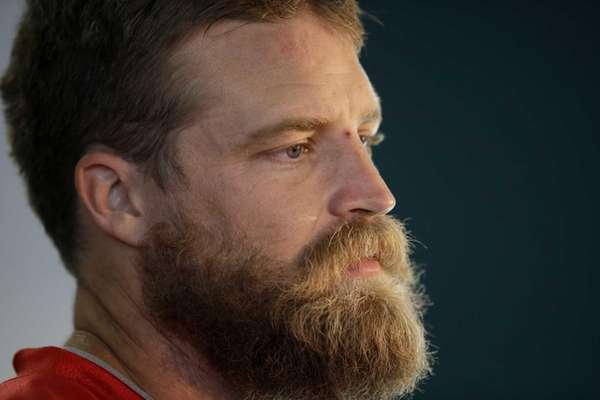 New York Jets quarterback Ryan Fitzpatrick gives a