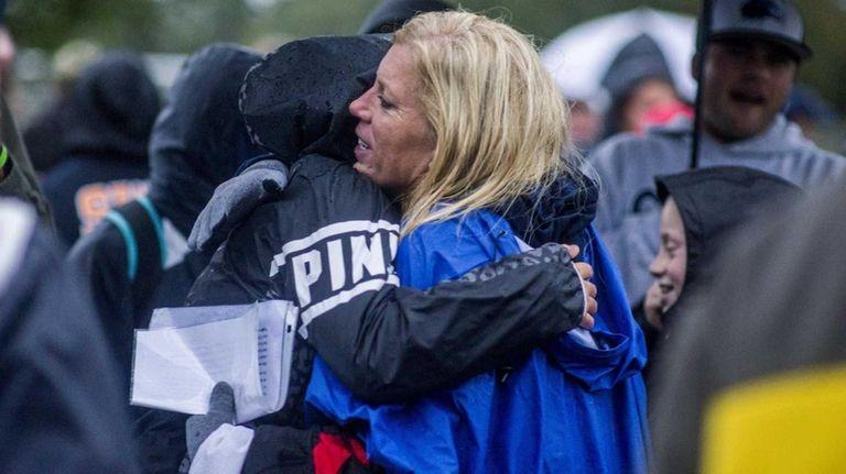 Kelli Cutinella, Thomas' mother, says goodbye to mourners
