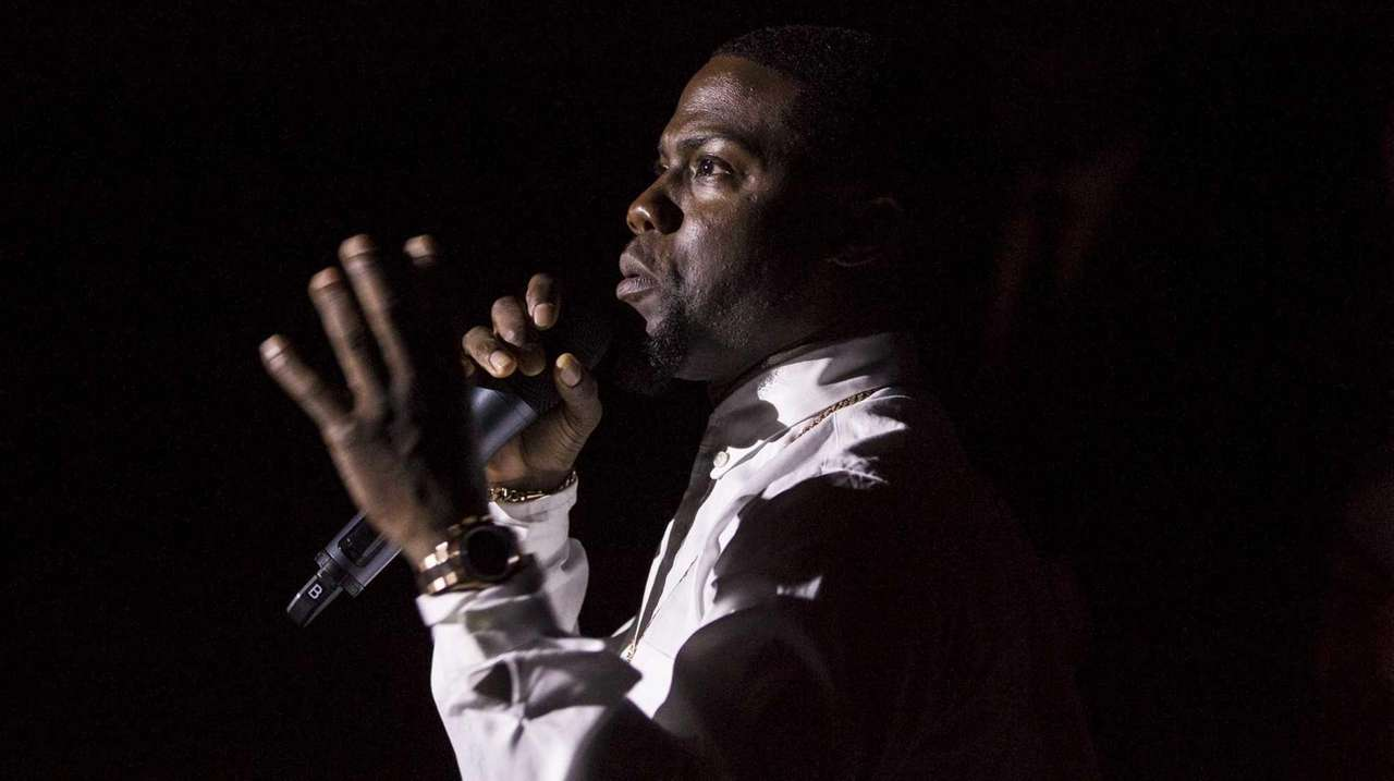 Kevin Hart speaks to fans at a red